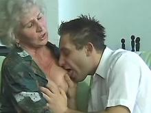 Grey haired granny sucks young cock