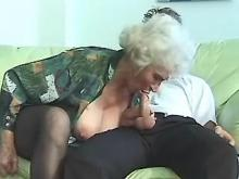 Grandma goes wild riding young cock