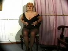 Kinky granny stuffs herself by toys