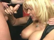 Busty granny in leather blows cocks