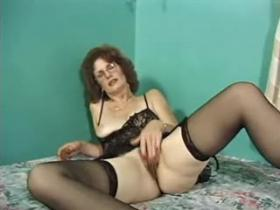 Aged mom in black lingerie slobbering her lovers cock