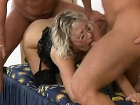 Two guys share horny mature slut in black lingerie