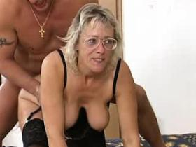 Horny mature in stockings shared by two young guys