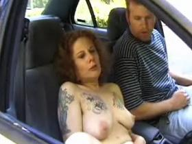 Tattooed granny throating her lover in the car