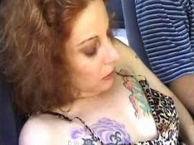 Tattooed mature slut throating dude in his car