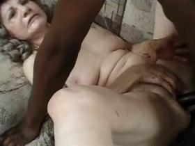 Old grey haired woman takes care of big black dick