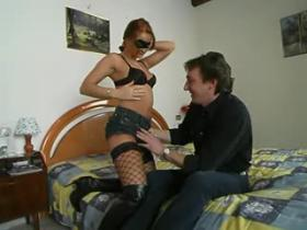 Redhead milf in fishnet stocking and boots throats