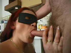 Redhead masked milf gets it off on the floor