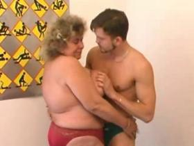 Fat breasty grandma pleasing young skinny dude