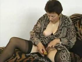 Grandma in stockings going wild with young lover