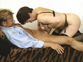 Granny in black stockings gets off with young dude