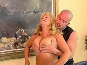 Chubby granny with big tits going naughty on floor
