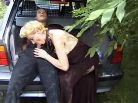 Granny whore with nice breast goes wild by the car
