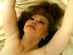 Redhaired mature has a fun on bed