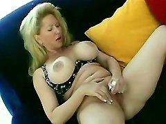 Huge tits mama toys pussy