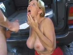 Dirty blond milf fucking in a car