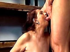 Nice old lady seduces man in garage