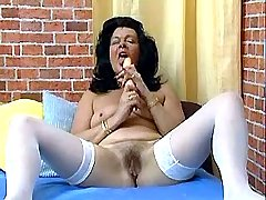Horny granny strips and goes nuts jerking off in bed