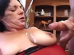 Brunette hot mature catches cum after fuck on sofa