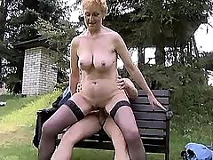 Redhead hot granny sucks and jumps on cock outdoor