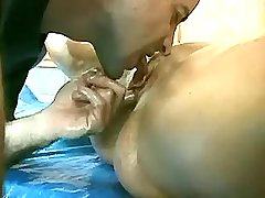 Athletic oiled mature is licked by dissolute guy