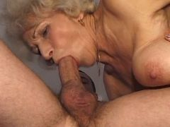 Granny deep throats big cock of man