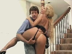 Blond mature does blowjob on stairs