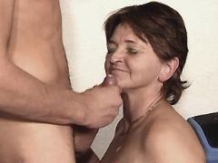 Mature fucks on table and gets cum